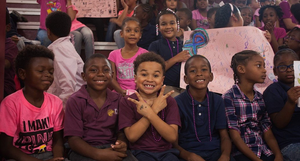 elementary students in stands