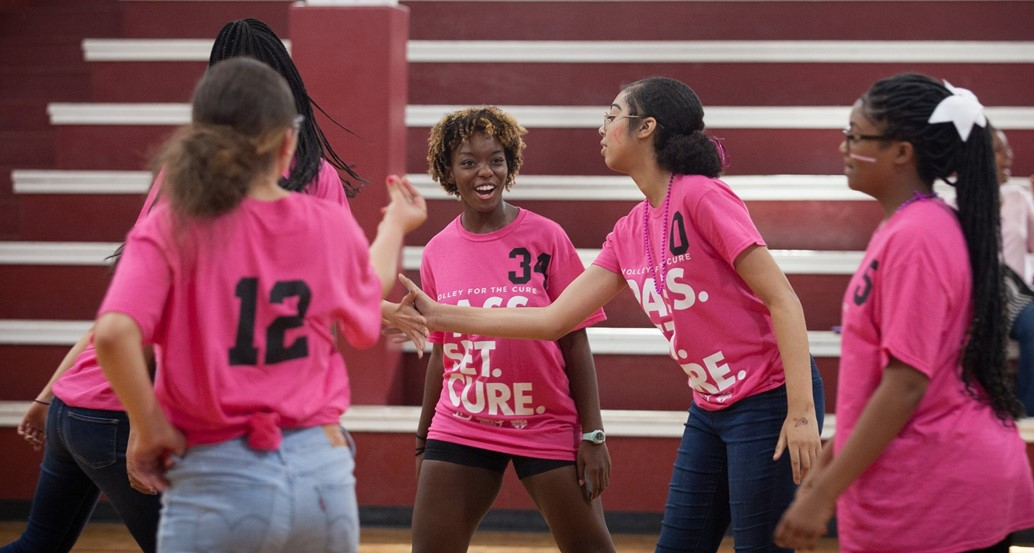 middle school volleyball team high-fiving
