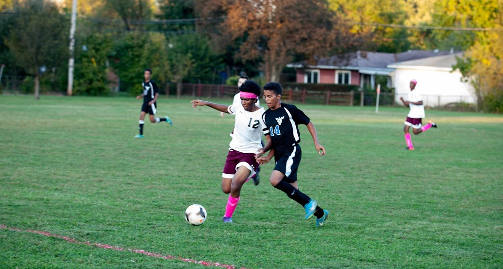 varsity soccer player going after ball