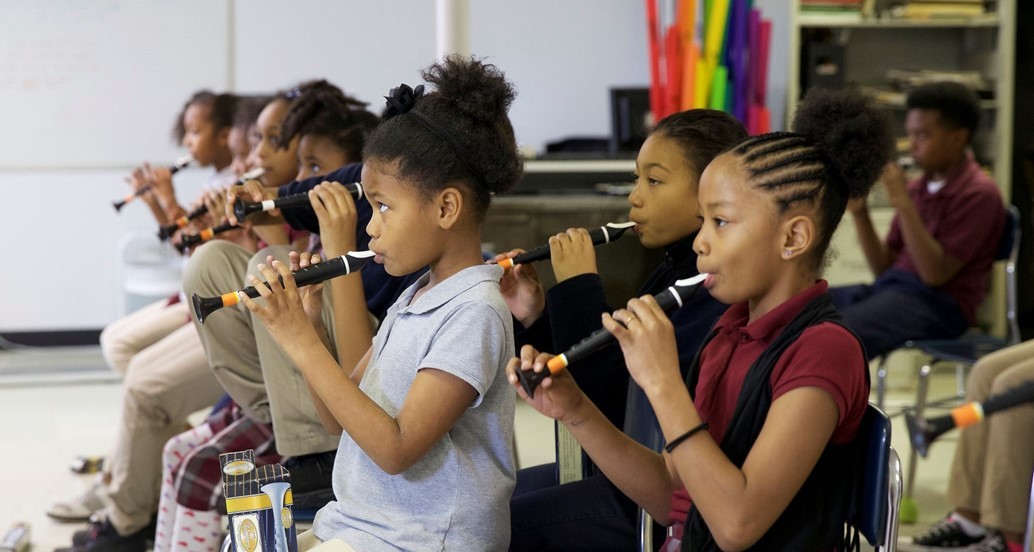 Students in music class playing instruments