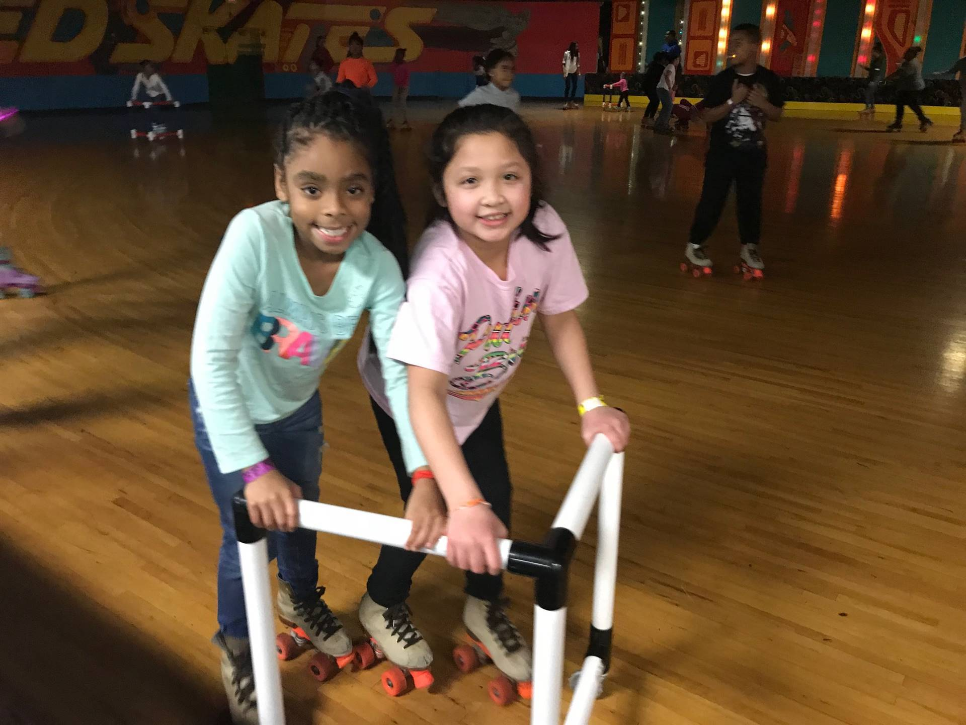 2 students rollerskating