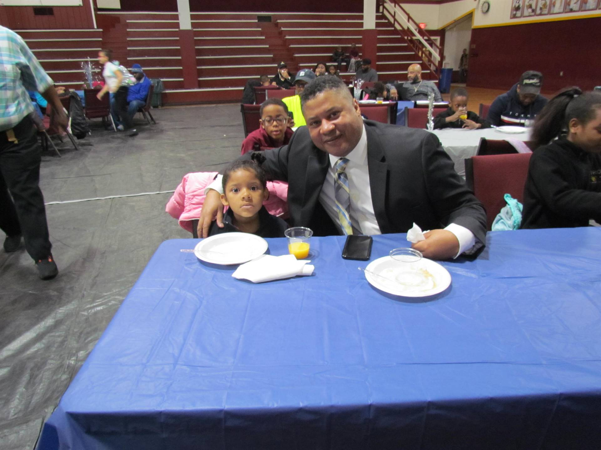 dad with his daughter eating pancakes