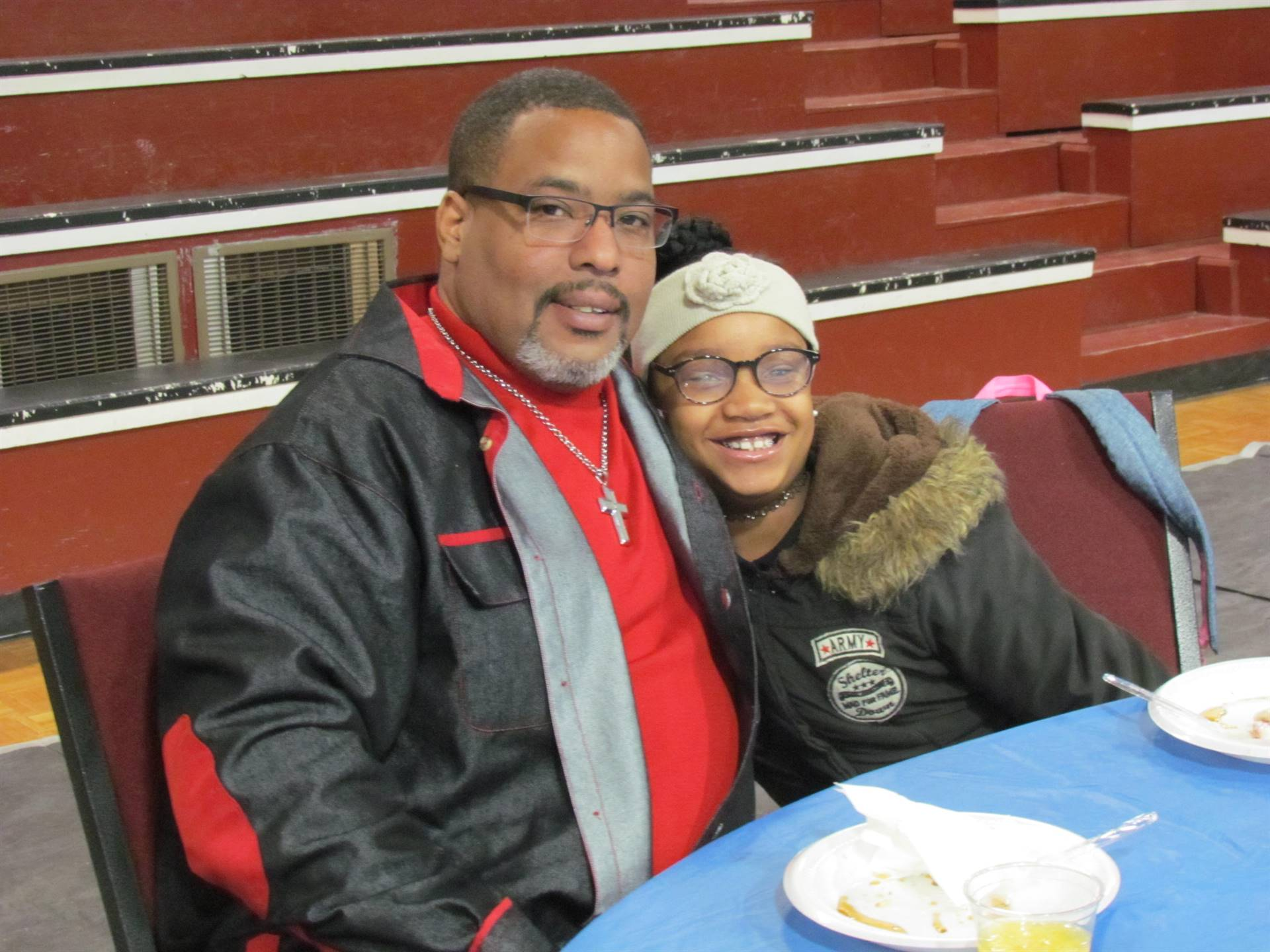 dad and daughter posing for picture