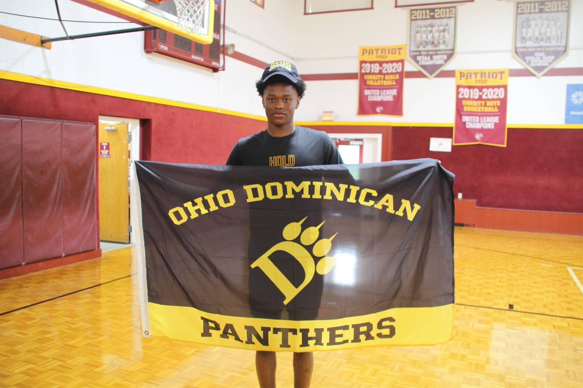 student holding ODU flag